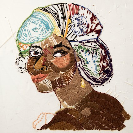 A Colourful embroidery of a woman by a member of Headway East London