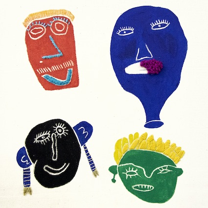 An Embroidery and print of four colourful faces.