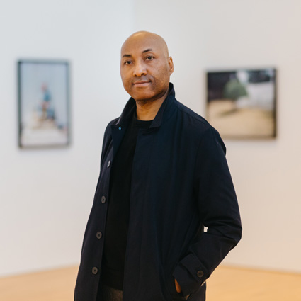 Photographer Andrew Jackson in his exhibition at MAC Birmingham