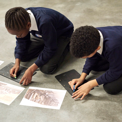 Autograph learning schools archive workshop. Pupils drawing from historical photographs